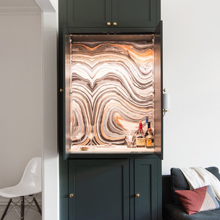 Small classic single-wall home bar in Raleigh with shaker cabinets, multi-coloured splashback, medium hardwood flooring, grey cabinets, no sink, marble worktops, stone slab splashback and brown floors.