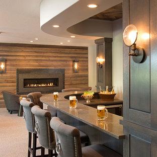 ミネアポリスの広いトランジショナルスタイルのおしゃれな着席型バー (人工大理石カウンター、L型、グレーのキッチンパネル、スレートの床、グレーのキッチンカウンター) の写真