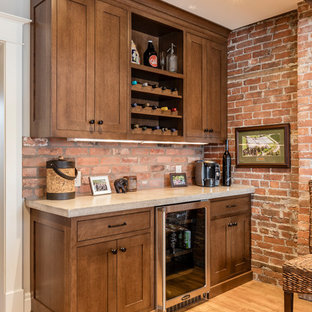 Medium sized rustic single-wall wet bar in Toronto with no sink, shaker cabinets, dark wood cabinets, marble worktops, brown splashback, brick splashback, light hardwood flooring and beige floors.