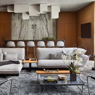 デンバーのコンテンポラリースタイルのおしゃれな着席型バー (ll型、フラットパネル扉のキャビネット、中間色木目調キャビネット、グレーのキッチンパネル、石スラブのキッチンパネル、グレーの床、グレーのキッチンカウンター) の写真