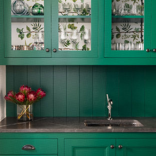 Photo of a large transitional single-wall wet bar in Austin with green cabinets, an undermount sink, glass-front cabinets, green splashback, timber splashback and grey benchtop.