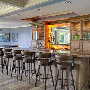 Photo of a large classic u-shaped breakfast bar in Chicago with raised-panel cabinets, medium wood cabinets, orange splashback, stone slab splashback, medium hardwood flooring, brown floors, brown worktops and granite worktops.