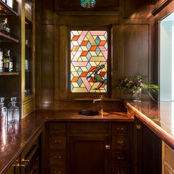 Bar with stained glass window of a historic Craftsman residence in Santa Monica,