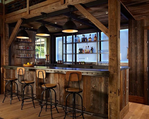 example of a country u shaped home bar design in other with medium