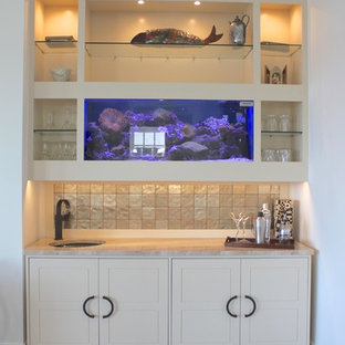 Photo of a small contemporary single-wall wet bar in New York with a submerged sink, shaker cabinets, white cabinets, marble worktops, ceramic splashback and vinyl flooring.