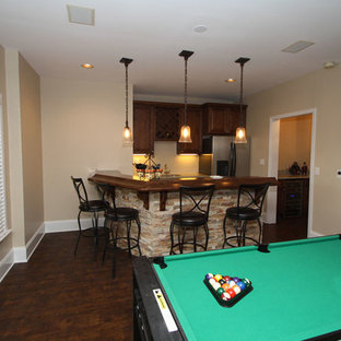 Example of a mid-sized classic l-shaped dark wood floor seated home bar design in Atlanta with medium tone wood cabinets and wood countertops