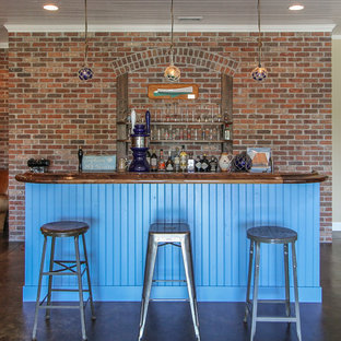 Example of a country seated home bar design in Denver with blue cabinets