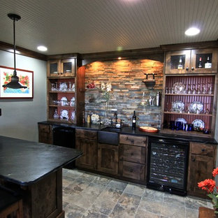 Design ideas for a medium sized traditional breakfast bar in Minneapolis with a submerged sink, shaker cabinets, dark wood cabinets, multi-coloured splashback, slate splashback, slate flooring and brown floors.