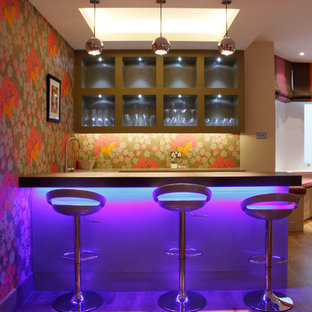 Photo of a contemporary home bar in London.