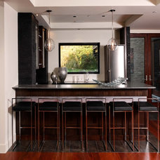 Contemporary Home Bar by KohlMark Architects and Builders
