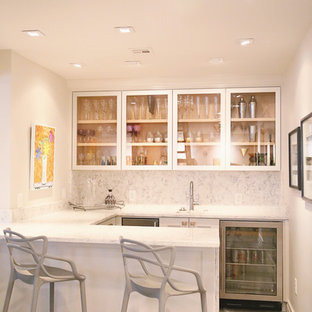 Design ideas for a medium sized contemporary galley breakfast bar in Other with a submerged sink, glass-front cabinets, white cabinets, marble worktops, white splashback, stone slab splashback and concrete flooring.
