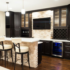 Contemporary Home Bar by Case Design & Remodeling Indy