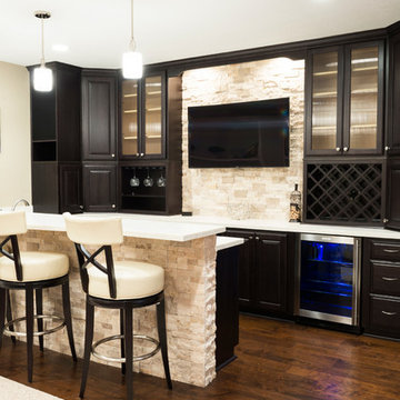 Basement Bar with Wood Flooring and Stone Wall