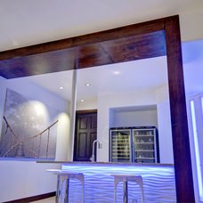 Contemporary Wine Cellar by Finished Basement Company
