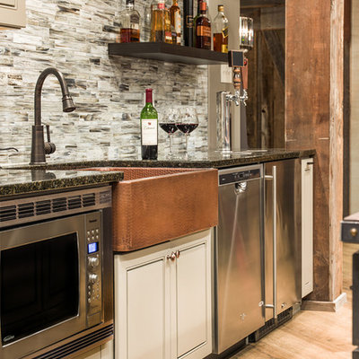 Example of a large mountain style porcelain tile wet bar design in Chicago with a drop-in sink, raised-panel cabinets, gray cabinets, granite countertops, multicolored backsplash and glass tile backsplash