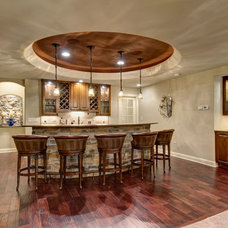 Traditional Home Bar by Finished Basement Company