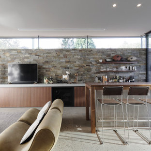 Inspiration for a mid-sized contemporary galley wet bar in Central Coast with an undermount sink, beaded inset cabinets, dark wood cabinets, concrete benchtops, grey splashback, stone slab splashback, concrete floors, grey floor and grey benchtop.