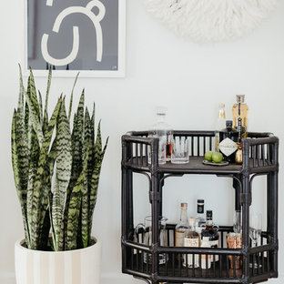 Inspiration for a beach style bar cart in Sydney with light hardwood floors and beige floor.