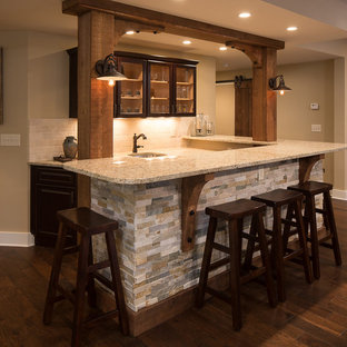Mid-sized mountain style l-shaped dark wood floor wet bar photo in Atlanta with an undermount sink, shaker cabinets, dark wood cabinets, granite countertops, beige backsplash and stone tile backsplash