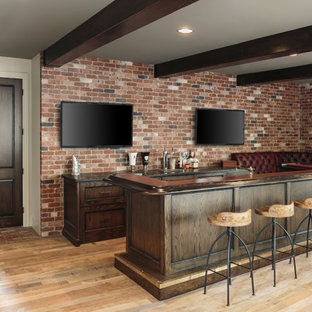 Example of a large urban l-shaped medium tone wood floor and brown floor seated home bar design in Portland with an undermount sink, furniture-like cabinets, dark wood cabinets, wood countertops, red backsplash, brick backsplash and brown countertops