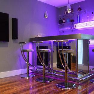 Bespoke corner bar in stainless steel with illuminated back bar shelving