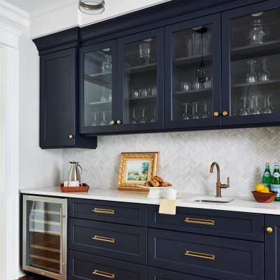 Transitional single-wall medium tone wood floor and brown floor wet bar photo in New York with an undermount sink, shaker cabinets, blue cabinets, gray backsplash and white countertops