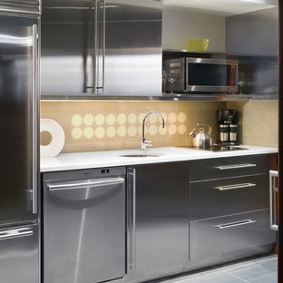Small modern single-wall wet bar in New York with a submerged sink, flat-panel cabinets, grey cabinets, marble worktops, yellow splashback, glass tiled splashback and slate flooring.