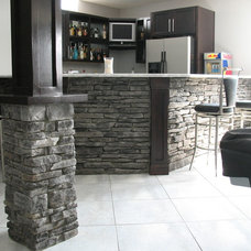 Traditional Basement by Brighton Stone & Fireplace, Inc.