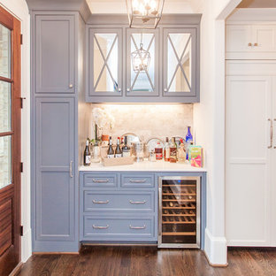 Coastal single-wall brown floor and medium tone wood floor home bar photo in Atlanta with gray cabinets, white countertops, no sink, recessed-panel cabinets and beige backsplash