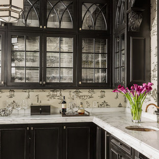 Example of a mid-sized transitional l-shaped porcelain floor and multicolored floor home bar design in Boston with an undermount sink, beaded inset cabinets, black cabinets, marble countertops and white countertops