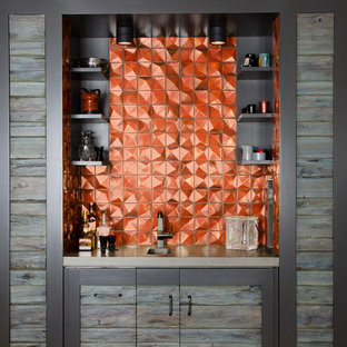 Inspiration for a small contemporary single-wall wet bar in Denver with grey cabinets and orange splashback.
