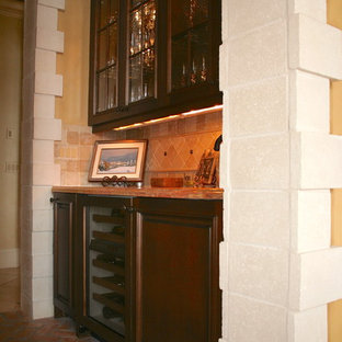 This is an example of a small classic single-wall wet bar in Miami with raised-panel cabinets, dark wood cabinets, beige splashback, stone tiled splashback, brick flooring and marble worktops.