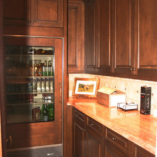 Design ideas for a small classic single-wall wet bar in Miami with raised-panel cabinets, dark wood cabinets, beige splashback, stone tiled splashback, brick flooring and marble worktops.