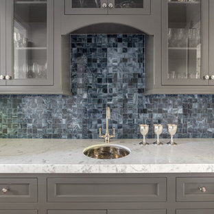 Photo of a small classic single-wall wet bar in San Francisco with a submerged sink, grey cabinets, marble worktops, blue splashback, glass tiled splashback and recessed-panel cabinets.