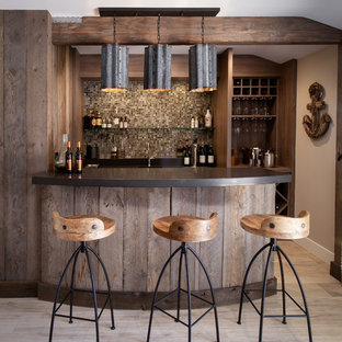Example of a coastal galley wet bar design in Los Angeles with dark wood cabinets and multicolored backsplash