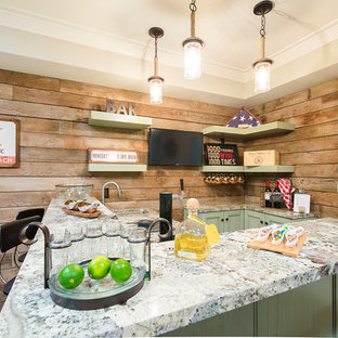 Inspiration for a beach style l-shaped medium tone wood floor seated home bar remodel in Los Angeles with recessed-panel cabinets, green cabinets and granite countertops