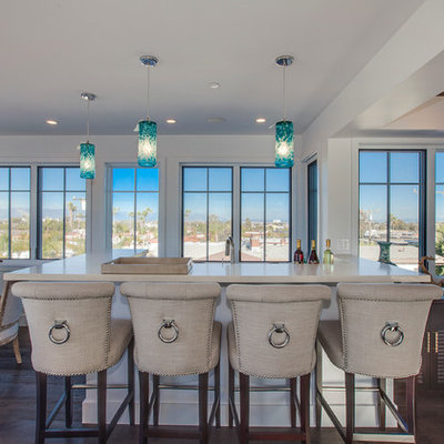 Inspiration for a coastal u-shaped dark wood floor seated home bar remodel in Los Angeles