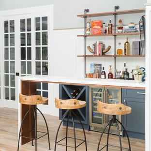 Inspiration For A Small Transitional Single Wall Light Wood Floor And Brown Wet Bar