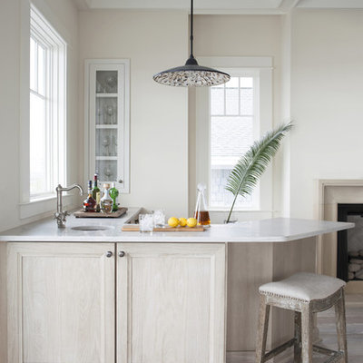 Inspiration for a mid-sized coastal l-shaped light wood floor and beige floor wet bar remodel in Atlanta with an undermount sink, recessed-panel cabinets, light wood cabinets, quartz countertops and white countertops