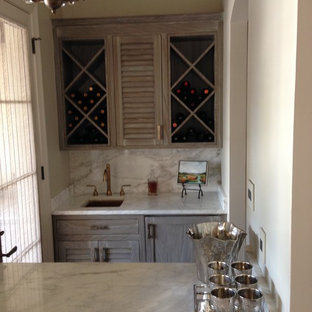 Small classic galley wet bar in New Orleans with shaker cabinets, a submerged sink, medium wood cabinets, marble worktops, grey splashback, marble splashback and grey worktops.