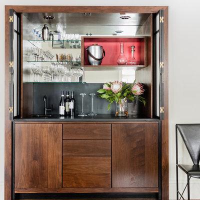 Small transitional single-wall dark wood floor and brown floor wet bar photo in Boston with an undermount sink, flat-panel cabinets, dark wood cabinets, black backsplash, soapstone countertops and mirror backsplash