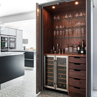 Photo of a contemporary single-wall home bar in Wiltshire with no sink, wood worktops, brown splashback, wood splashback, multi-coloured floors and brown worktops.