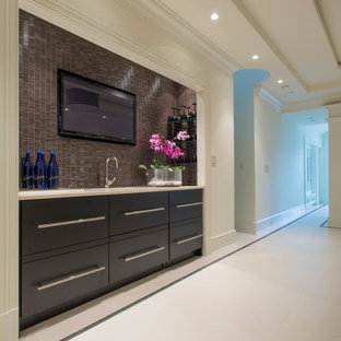 Design ideas for a medium sized traditional single-wall wet bar in DC Metro with a submerged sink, flat-panel cabinets, black cabinets, marble worktops, black splashback and mosaic tiled splashback.