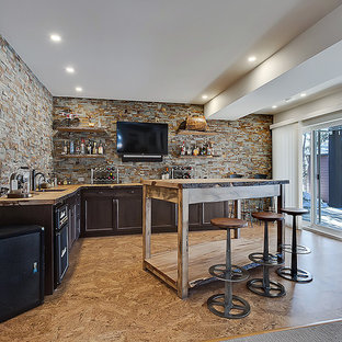 Seated home bar - small traditional l-shaped linoleum floor and brown floor seated home bar idea in Calgary with an undermount sink, shaker cabinets, dark wood cabinets, wood countertops, multicolored backsplash and stone tile backsplash