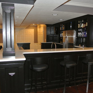 Inspiration for a home bar remodel in Other with white countertops