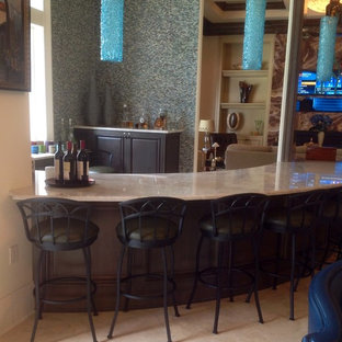 Large beach style galley wet bar in Miami with raised-panel cabinets, dark wood cabinets, marble worktops, blue splashback and matchstick tiled splashback.