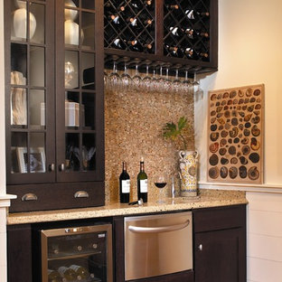 Example of a mid-sized classic single-wall wet bar design in Atlanta with glass-front cabinets, dark wood cabinets, beige backsplash and mosaic tile backsplash
