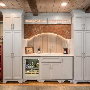 Huge elegant single-wall medium tone wood floor wet bar photo in Columbus with shaker cabinets, quartz countertops, white countertops, an undermount sink, gray cabinets and wood backsplash