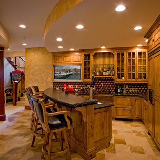 Inspiration for a mid-sized rustic u-shaped seated home bar remodel in Chicago with raised-panel cabinets, medium tone wood cabinets, multicolored backsplash and mosaic tile backsplash
