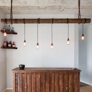 ナッシュビルの中サイズのインダストリアルスタイルのおしゃれなホームバー (I型、シンクなし、家具調キャビネット、濃色木目調キャビネット、木材カウンター、竹フローリング、ベージュの床、茶色いキッチンカウンター) の写真